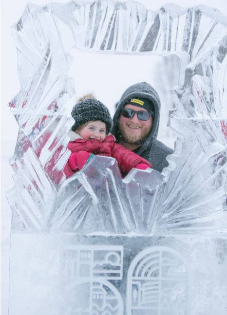 Man and little girl in 50th ice sculpture frame