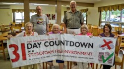 residents of pioneer ridge holding up sign that celebrates going styrofoam free