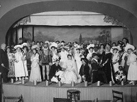 A troupe of actors stands on stage at Port Arthur Town Hall