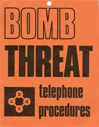 An orange poster with bold wording that says bomb threat