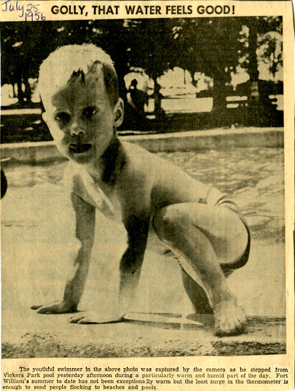 A newspaper clipping shows a child getting out of a pool