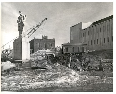 A building is being demolished with construction equipment