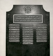 A wooden plaque with metal name plates detailing those who had been lost