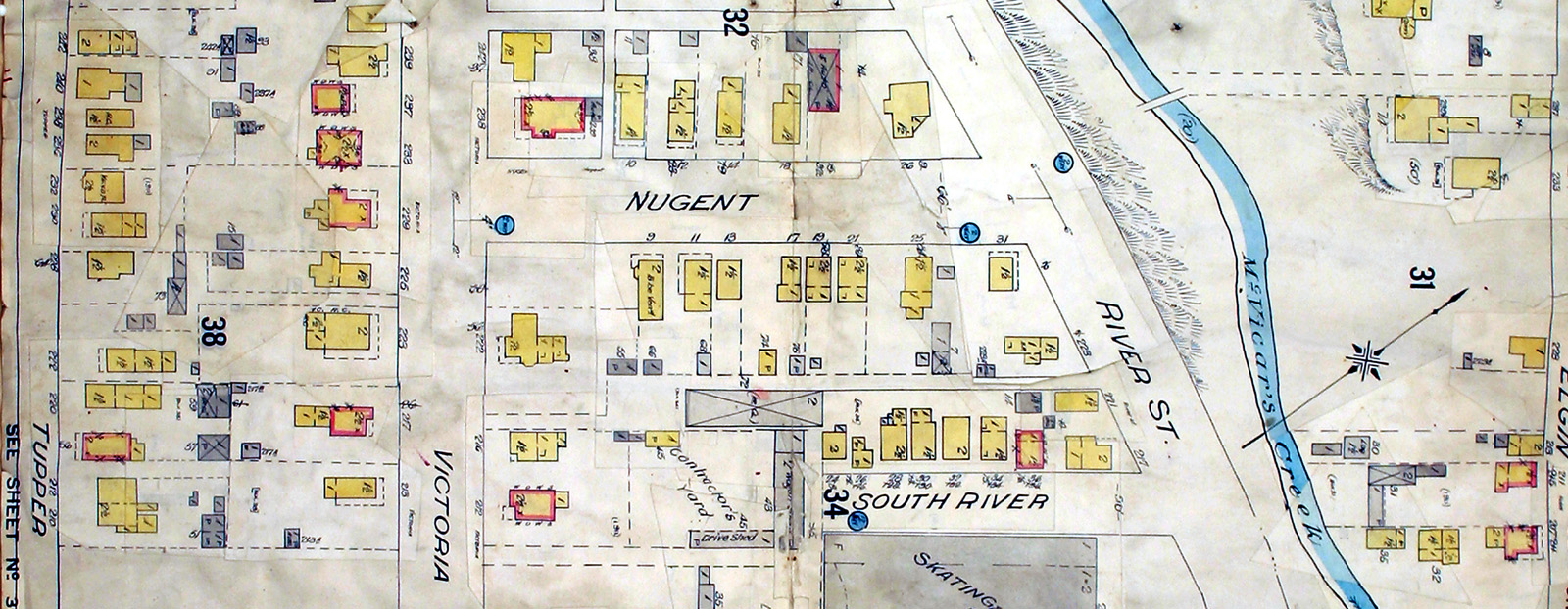 A cut out section of a map showing housing lots and streets