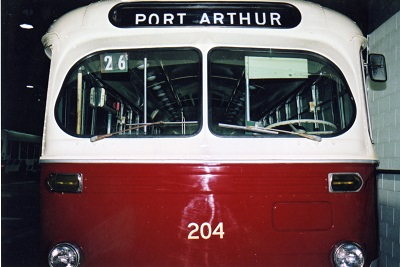 a red and white Port Arthur trolley