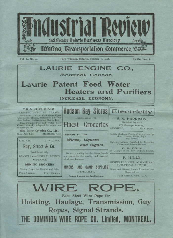 A blue paper with black writing that says industrial review at the top