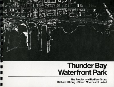 The front cover of a booklet depicts an aerial view of the waterfront