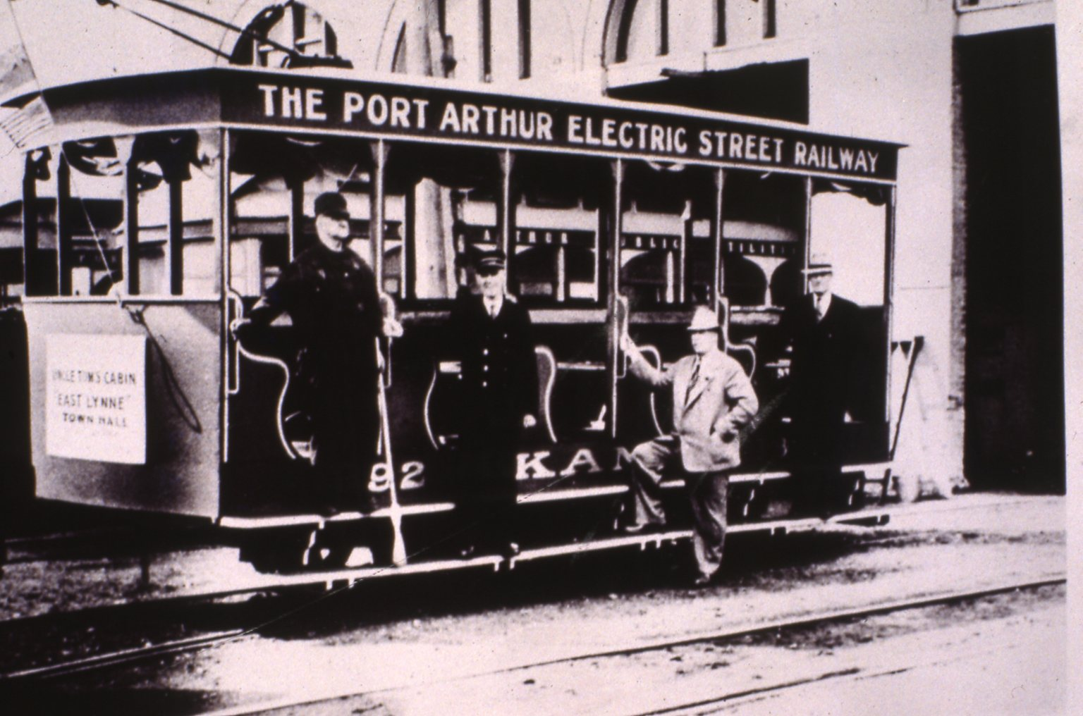 an electric railway car carrying multiple people