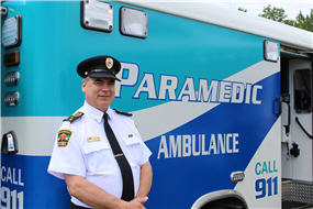 Wayne Gates standing in front of an ambulance
