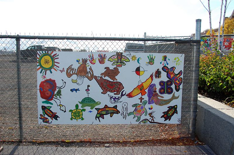 Mural on fence by baggage building