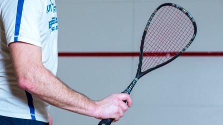person holding squash raquet