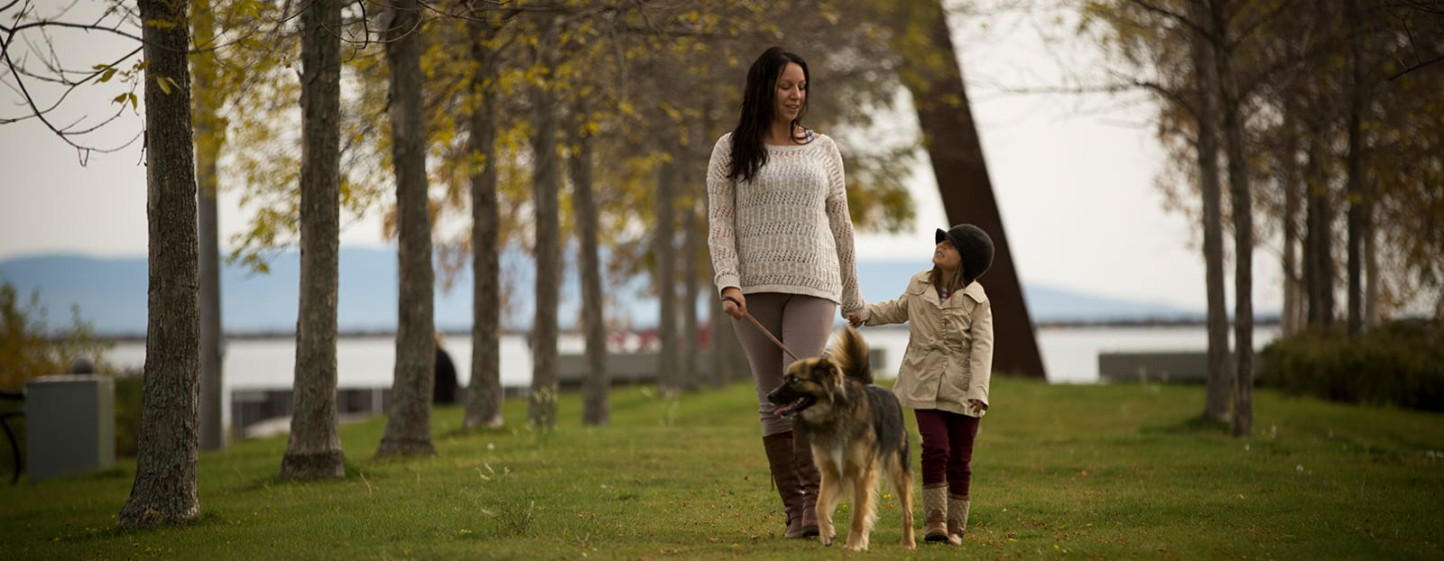 mother and daughter walking with their dog