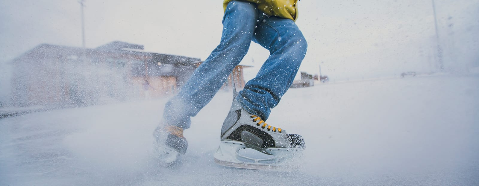 skater spraying snow at camera