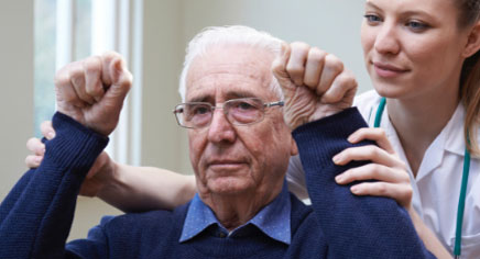elderly man with arms in air